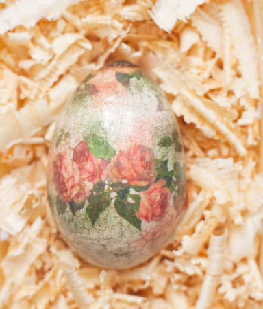 easter egg made decoupage methods on sawdust photo