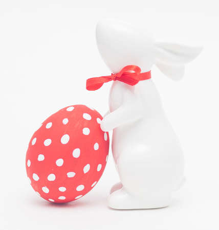 easter porcelain bunny with colorful egg
