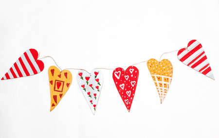 garland of homemade wooden hearts in white Stock Photo - 17560895