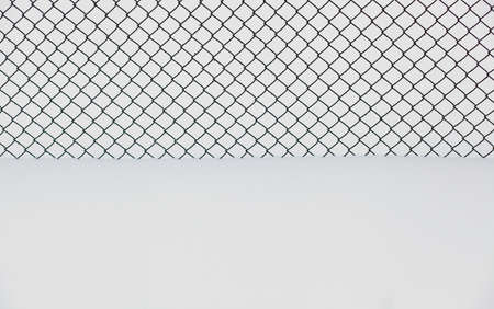 jail background: seamless fence chain on snow background