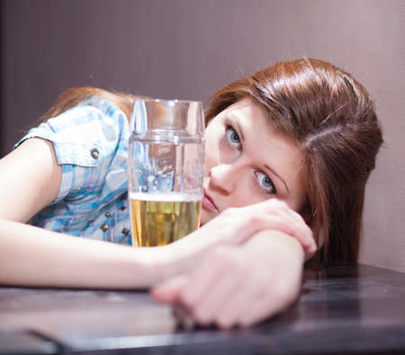 disgusting looking woman with a glass of beer Stock Photo - 17561102