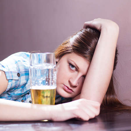 disgusting looking woman with a glass of beer photo