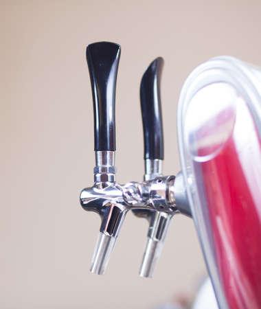 beer pump: Beer taps in a bar for spilling drinks