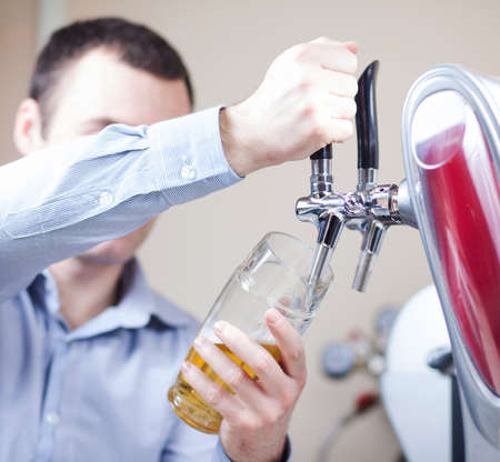 glass being filled with draft beer by barman Stock Photo - 17561100