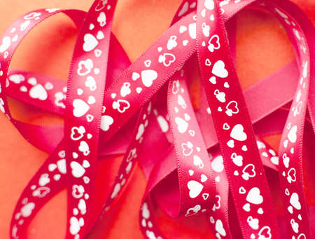 gift ribbon with heart on red paper