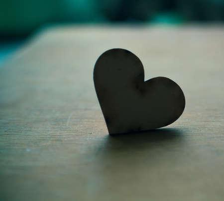 wood heart on wooden board