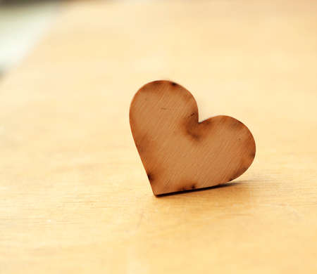 wood heart on wooden board