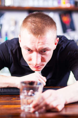 Young  professional barman in action making cocktail drinks Stock Photo