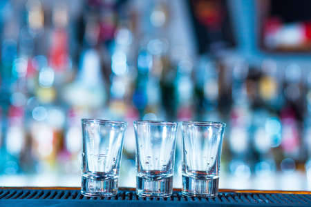 Empty glasses at a bar Stock Photo
