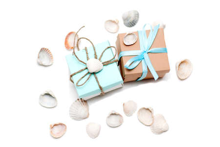 small gifts with conchs on white background Stock Photo