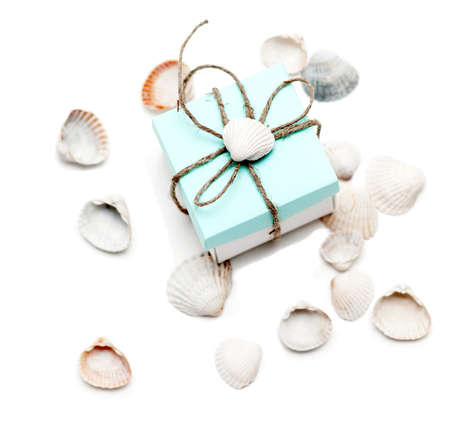 bonbonniere: small gift with conchs on white background Stock Photo
