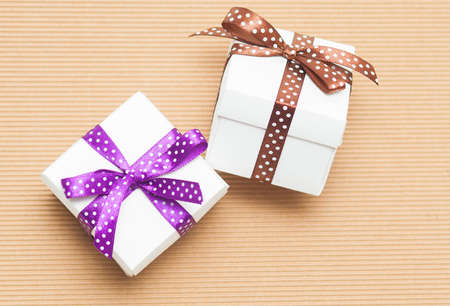A colorful assortment of small gifts tied with bows photo
