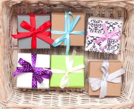 A colorful assortment of small gifts tied with bows