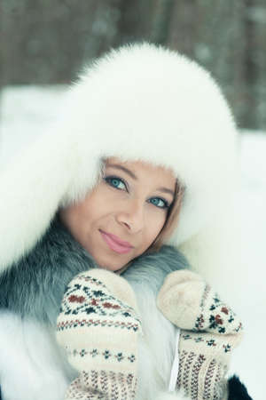 Portrait of a beautiful woman on winter park photo