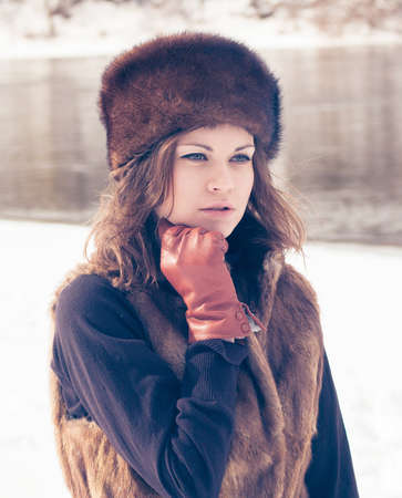 Portrait of a beautiful girl in a fur hat photo