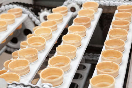 Preparation of ice-cream on factory photo
