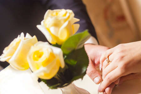 Hands and rings with rose  bouquet