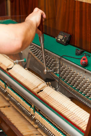 upright piano: Detailed view of Upright Piano during a tuning