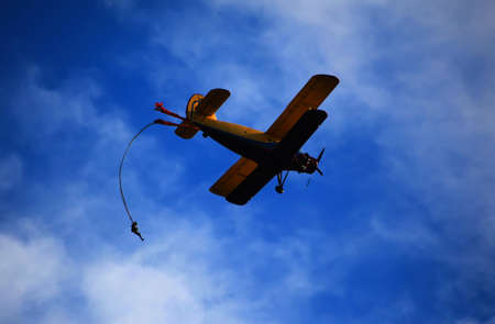 Parachutist jumps aircraft blue sky background Stock Photo