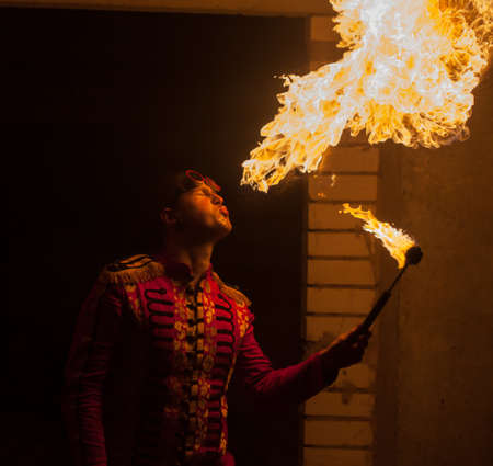 fire show: Fire show artist breathe fire in the dark Stock Photo