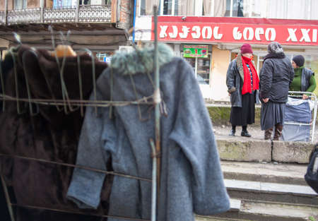 KUTAISI, GEORGIA - FEBRUARY 23, 2016: women sell clothes in a street market. Editorial