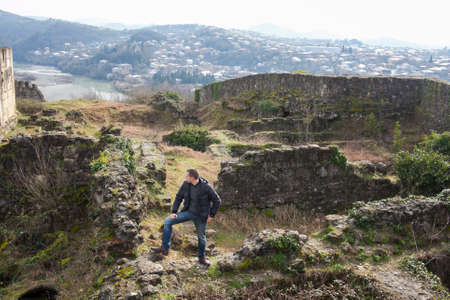 KUTAISI, GEORGIA - FEBRUARY 23, 2016: A man stands on the ruins of an ancient fortress. Editorial