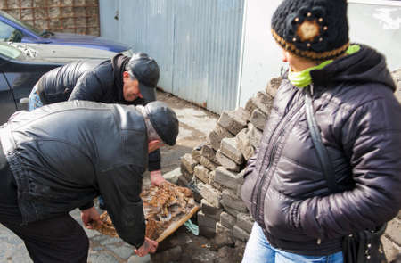 KUTAISI, GEORGIA - FEBRUARY 23, 2016: older men are selling the meat on street market.