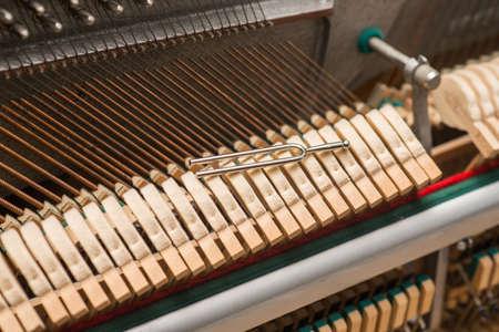 tool with vintage piano hammer mechanism. Prepare to repair.