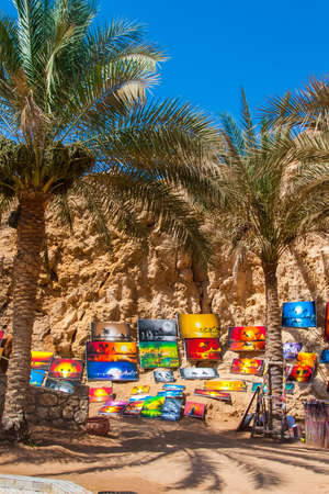 SHARM EL SHEIKH, EGYPT - JULY 9, 2019. The paintings are sold on the sea coast. Editorial
