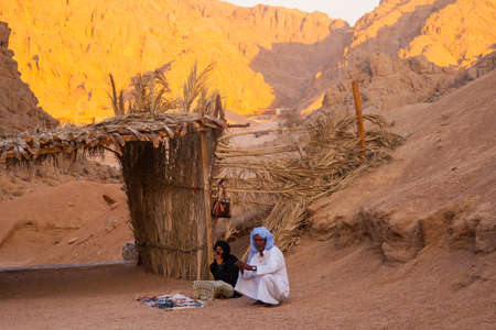 SHARM EL SHEIKH, EGYPT - JULY 9, 2009. Bedouin and Muslim woman selling goods to tourists in the desert.