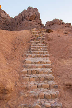 stone staircase leading up into the wilderness. Foto de archivo