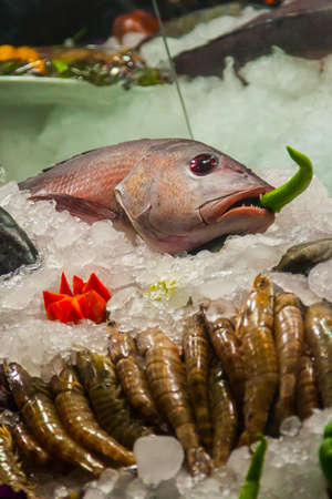 beautiful fish lies on ice at the market.