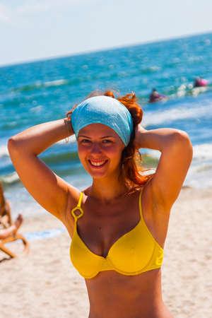 happy young woman posing in bikini swimsuit. Foto de archivo
