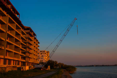 CONSTANTA, ROMANIA - AUGUST 21, 2010. Construction of high-rise house on the lake.