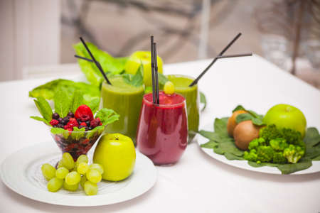 Healthy green and red smoothies and ingredients - superfoods, detox, diet, health, vegetarian food concept