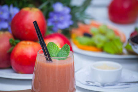 Healthy red smoothie and ingredients - superfoods, detox, diet, health, vegetarian food concept