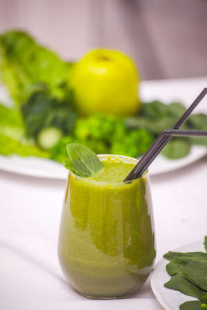 Healthy green smoothie and ingredients - superfoods, detox, diet, health, vegetarian food concept