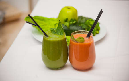 Healthy green and red smoothies and ingredients - superfoods, detox, diet, health, vegetarian food concept.