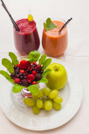 Healthy red smoothies and ingredients - superfoods, detox, diet, health, vegetarian food concept