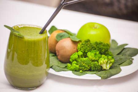 Healthy green smoothie and ingredients - superfoods, detox, diet, health, vegetarian food concept