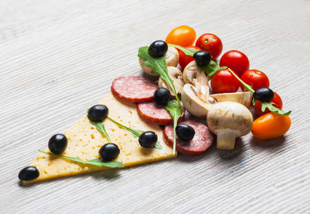 Christmas tree shaped pizza with cherry tomatoes and olives Stock Photo