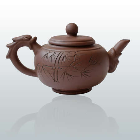 Clay teapot with reflection photo