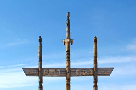 hitching post: A wooden sculpture of the blue sky