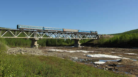 mainline: The little train moving bridge in the forest on the Baikal-Amur Railway in Yakutia