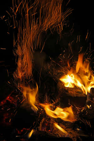 bivouac: Flames of a campfire with flying sparks