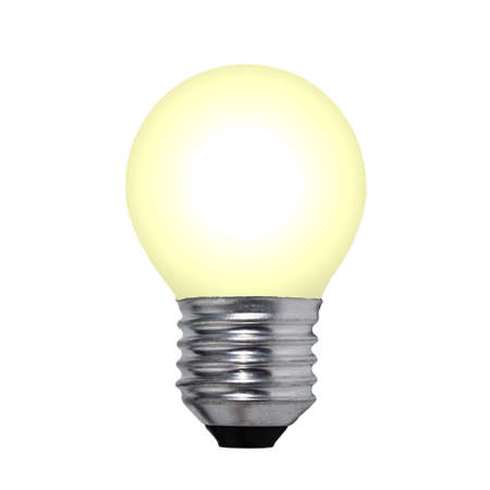 yellow light bulb on a white background isolated close-up photo