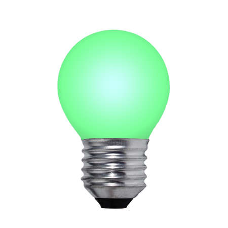 Green light bulb on a white background isolated close-up photo
