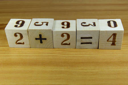 additional training: Cubes with the numbers stacked in a mathematical expression Stock Photo