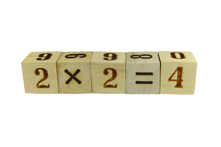 Cubes with the numbers stacked in a mathematical expression Stock Photo