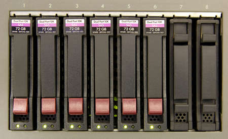 gigabytes: an array of six hard drives for storage close-up
